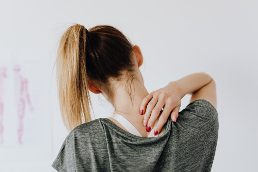 a woman experience neck pain